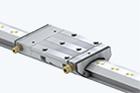 Prowadnice liniowe z kompaktowym prowadzeniem hydrostatycznym HLE